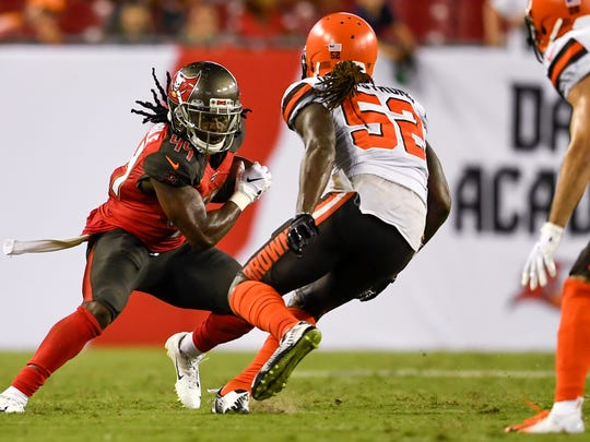 Aug 23, 2019; Tampa, FL, USA; Tampa Bay Buccaneers running back Dare Ogunbowale (44) runs with the ball as Cleveland Browns linebacker Ray-Ray Armstrong (52) defends during the second half at Raymond James Stadium. Mandatory Credit: Douglas DeFelice-USA TODAY Sports