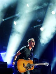 Eric Church performs during the CMA Music Festival at LP Stadium June 14, 2015.