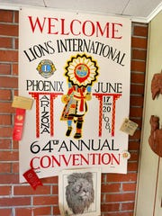 A poster for the Lions International 64th Annual Convention hangs on the wall of Peter Larson, Thursday, November 12, 2015, in Salem, Ore.