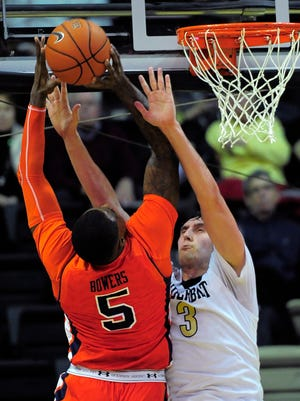 Vanderbilt forward Luke Kornet (3) tries to stop Auburn forward Cinmeon Bowers (5) as he shoots in the first half Tuesday at Memorial Gym.