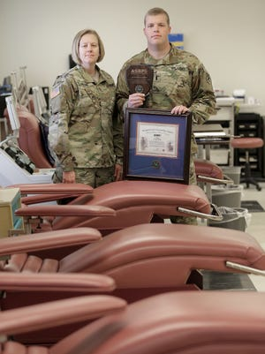 Maj. Jennifer Marin, left, is the officer in charge of the Fort Bliss Blood Donor Center. First Lt. Frank Kirsopp, with 3rd Battalion, 43rd Air Defense Artillery Regiment, organized blood donor drives within 11th Air Defense Artillery Brigade and was honored at the recent Blood Donor Recognition Ceremony.