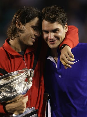 In this Feb. 1, 2009 file photo, Rafael Nadal consoles Roger Federer  during the trophy presentation during the 2009 Australian Open.
