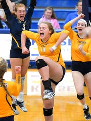 St. Ursula's Mary Shaffer celebrates after a crucial point against Mercy Sept. 21