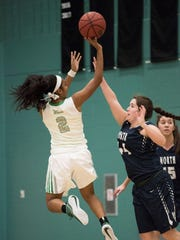 Fort Myers' Janay Outten goes up for a floater  in
