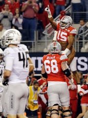Ohio State's Ezekiel Elliott celebrates his touchdown