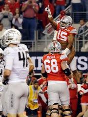 Ohio State's Ezekiel Elliott celebrates his touchdown