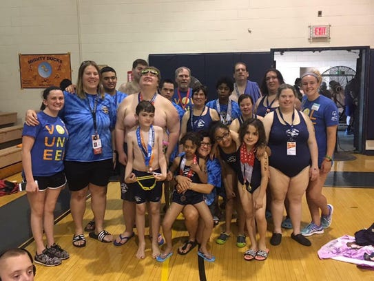 Nineteen swimmers on the JCC Rising Tide Special Olympics