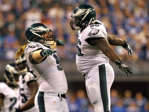 Eagles defensive tackle Beau Allen (94) and nose tackle Bennie Logan (96) celebrate during the third quarter against the Indianapolis Colts at Lucas Oil Stadium.