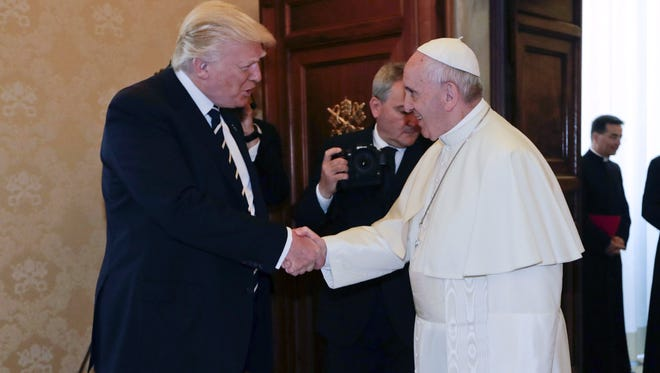 Pope Francis shakes hands with President Trump on the occasion of their private audience at the Vatican in Vatican City, May 24, 2017.