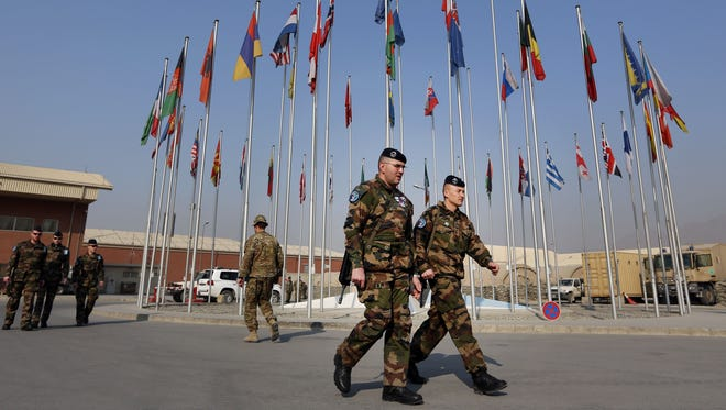 French soldiers leave a NATO handover ceremony at the Hamid Karzai Airport in Kabul, Afghanistan, on  Dec. 31, 2014.