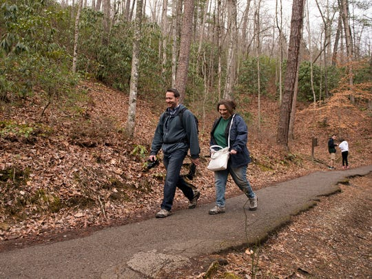 """Dan and Michelle Ramsey of Clarksville hike to Laurel Falls in the Great Smoky Mountains National Park on Wednesday, Feb. 22, 2017. The Ramseys visit the area five or six times a year. """"We actually came right after (the fire),"""" Dan Ramsey said. """"It's what the businesses need. They survive on tourism. Come spend some money and give some love."""""""