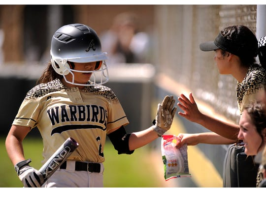 Abilene High's Cierra Woodyard (2) is congratulated by teammates after scoring a run in the bottom of the sixth inning of the Lady Eagles' 6-3 win on Wednesday, March 29, 2017, at Abilene High School.