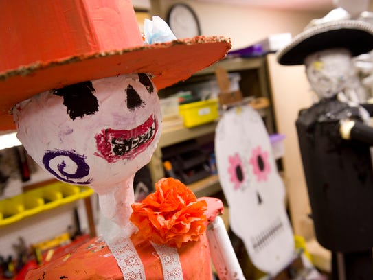 La Katrina, left, an ofrenda figure used in teacher Eric Ridenour's Day of the Dead class project last year.