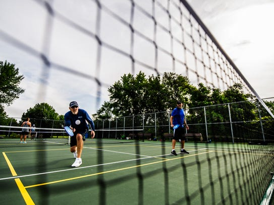 Jim Roedel returns the ball in a doubles pickleball