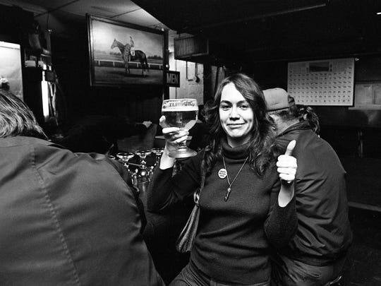 Linda Joyce Simpson gives the thumbs-up sign as she hefts a mug of beer after an exercise in equal rights at the bar of the Gerst House Restaurant on March 1, 1975. Angered by reports that the restaurant had refused to serve unescorted women at its bar, about a dozen women led by reporter Drue Smith marched in at high noon to test the policy.