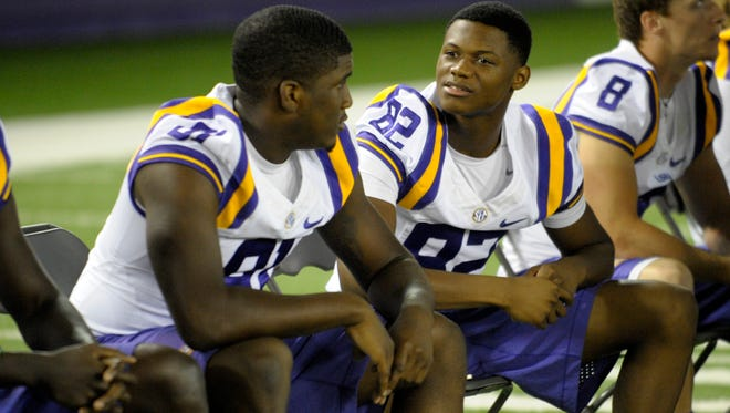 LSU wide receiver D.J. Chark (82) speaks to receiver Tony Upchurch (81) during LSU Media Day at the LSU Charles McClendon Football Practice Facility in Baton Rouge on Aug. 10.