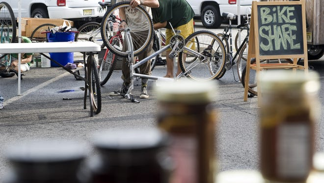Rich Everill, 22, of Collingswood, repairs a bicycle for the newly started Collingswood Bike Share during the Farmers Market on Saturday morning, August 30, 2008. Denise Henhoeffer/Courier-Post