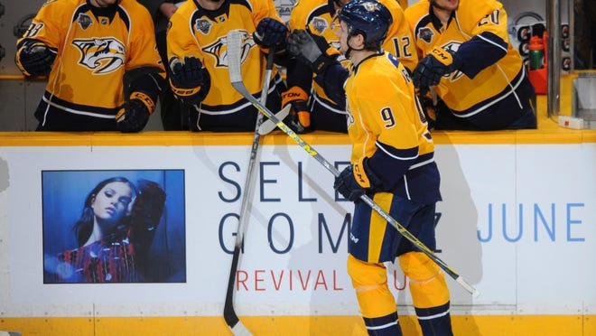 Predators left wing Filip Forsberg (9) is congratulated by teammates after a goal in the first period Thursday.