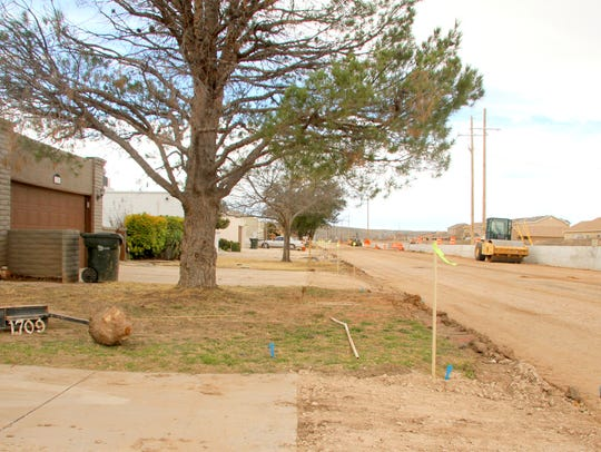 Several feet of front yards on Callaway will be paved