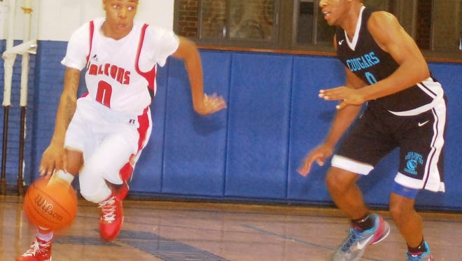 Manchester senior guard Patrick Wilson moving down the court against North 13th Street Tech.