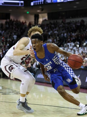 Kentucky Wildcats guard Shai Gilgeous-Alexander (22) drives to the basket against South Carolina Gamecocks guard Hassani Gravett (2) during the first half at Colonial Life Arena in Columbia, South Carolina, on Tuesday, Jan. 16, 2018.