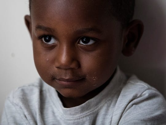 Cheefh Drew, 3, sits on his bed at his home in Wilmington.