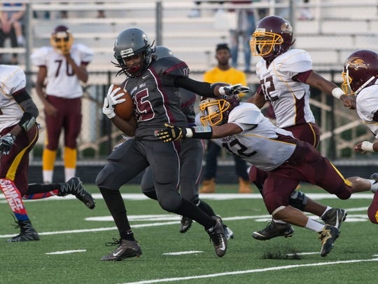 Snow Hill's Rayson Baine (15) attempts to shake a tackle
