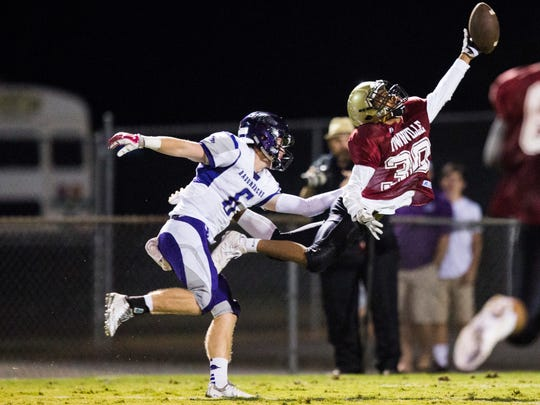 Pendleton's Jason Wright (30) nearly picks a pass intended