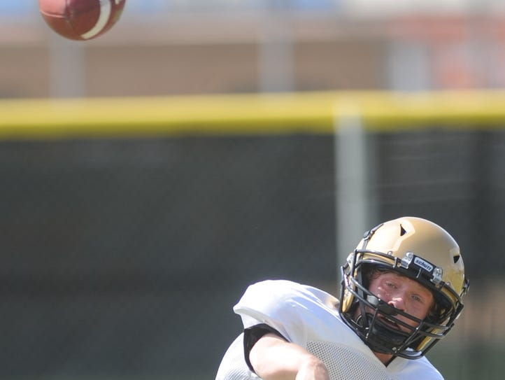 Abilene High quarterback Andrew Ezzell throws a pass