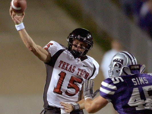 File- This Oct. 30, 2004, shows Texas Tech quarterback Sonny Cumbie (15) passing the ball under pressure from Kansas State linebacker Ted Sims (45) in an NCAA college football game in Manhattan, Kan. Leach's former Tech quarterbacks are gaining prominence as coaches at Big 12 programs. Lincoln Riley recently was promoted from offensive coordinator to head coach at Oklahoma. Kliff Kingsbury has been the head coach at Texas Tech since 2013, and his offenses have been nearly unstoppable. Cumbie is entering his fourth season as TCU's co-offensive coordinator, and his units with quarterback Trevone Boykin were among the best in college football.  (AP Photo/Charlie Riedel, File)