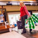 Kritstol Andelin of Des Moines shops at  Jordan Creek Town Center on Black Friday. The West Des Moines mall will have new and expanded stores coming in 2016.