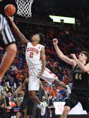 Clemson guard Marcquise Reed (2) scores past Wake Forest forward Konstantinos Mitoglou (44) during a game last season.