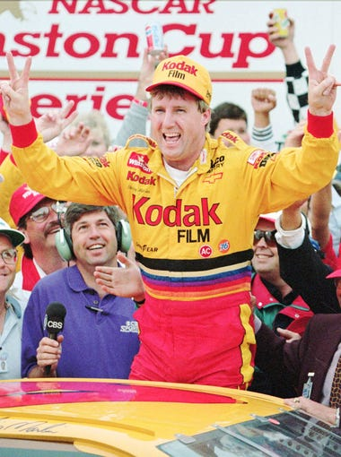 "Sterling Marlin, from Columbia, Tenn., flashes the ""two"" sign in Victory Lane after winning his second straight Daytona 500 Sunday afternoon Feb. 19, 1995 at Daytona International Speedway."