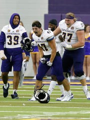 Western Illinois' Michael Bishoff(47) and James Torgerson
