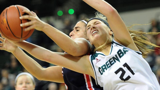 Green Bay's Jessica Lindstrom (21) battles for the ball against Belmont's Frankie Joubran at the Kress Center on Tuesday.