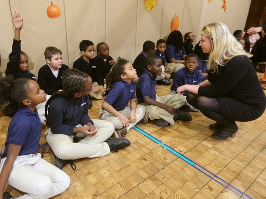 Emily Volpe, principal at Rochester Prep Charter School, talks with third-graders during an assembly.  Rochester Prep has nearly 2,000 students on its wait list with third and fourth grade being the most popular.