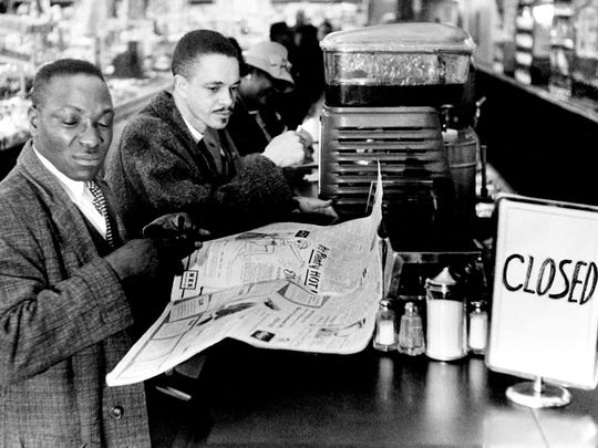 Two black ministers, the Rev. J.L. Copeland, left, pastor of Zion Baptist Church, and the Rev. J. Metz Rollins Jr., pastor of the United Presbyterian Church, join in a small sit-down demonstration against lunch counter segregation at downtown Woolworth's dime Store March 1, 1960.
