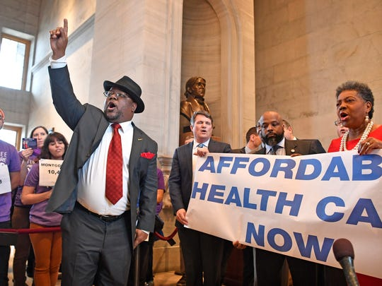 Rep. Antonio Parkinson, D-Memphis, joins with protesters