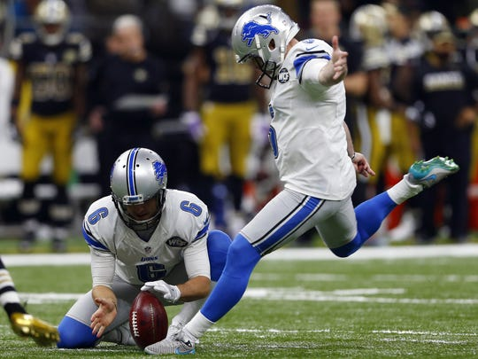 Detroit Lions kicker Matt Prater kicks a field goal as Sam Martin holds in the second half of an NFL football game against the New Orleans Saints in New Orleans, Sunday.