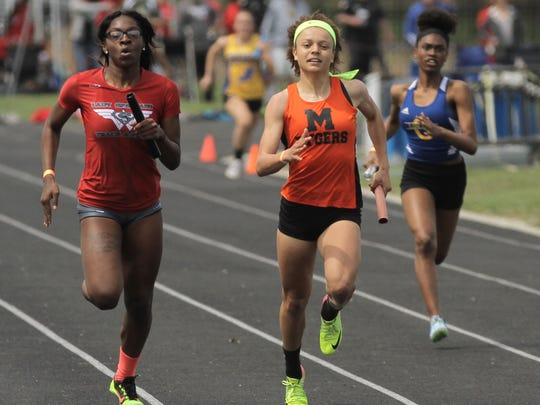 Anchor runner Alaysia Grose comes from behind to give Mansfield Senior the 4x200 title in Saturday's 85th Mehock Relays.