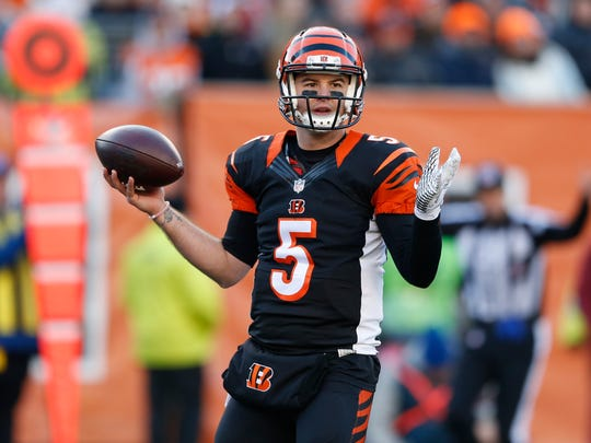 Cincinnati Bengals quarterback AJ McCarron (5) looks to pass in the second half of an NFL football game against the Baltimore Ravens, Sunday, Jan. 3, 2016, in Cincinnati. Cincinnati won 24-16. (AP Photo/Gary Landers)