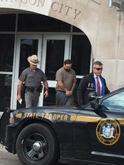 Paul Warner, center, is accused in a West Corners shooting. He was arraigned in October in Union Town Court and sent to the Broome County jail.