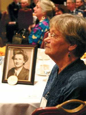 Terry England attends a ceremony in honor of those who served in the Civil Air Patrol during World War II. England's mother, Bonnie Baker, who died in 1973, was part of the patrol and monitored power stations along the Muskingum River.