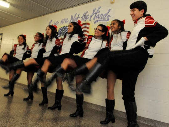 Diego Ordonez, a Clifton High School sophomore, became the first male majorette in the band's 79-year history.  Here, Ordonez and the Mustang Majorettes work on their high kicks before the Clifton Kicks Cancer Talent Showcase on Jan. 20.