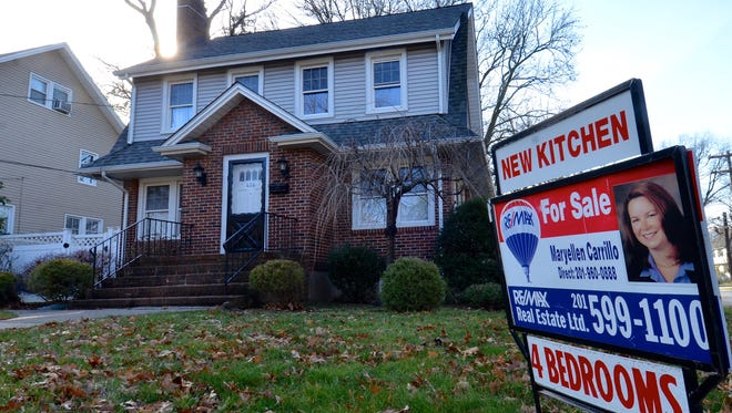 For sales sign at 416 W.   Englewood Ave. in Teaneck. Americans shrugged off rising mortgage rates and bought existing homes in January at the fastes+t pace since 2007.  Home sales rose 3.3 percent in January from December to a seasonally adjusted annual rate of 5.69 million, the National Association of Realtors said Wednesday.