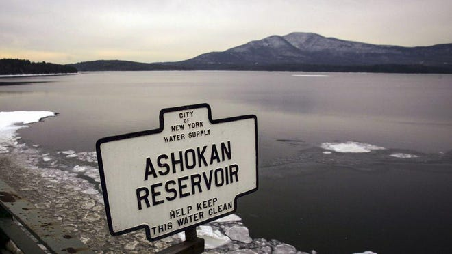 FILE - This photo from Dec. 19, 2007, shows a sign marking the Ashokan Reservoir in Shokan, N.Y. State regulators have been working to require public water systems to test for and clean up three contaminants linked with long-term health risks such as severe kidney and liver damage.