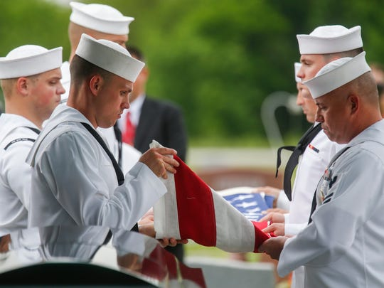 Members of the United States Navy Honor Guard remove the flag from Clifford George Goodwin's coffin during his funeral service at the Diamond Cemetery on Saturday, May 12, 2018. Goodwin was killed at Pearl Harbor during World War II while serving aboard the USS Oklahoma with the U.S. Navy. His remains were recently identified using DNA analysis and he was returned to Missouri from Hawaii to be buried with full military honors.