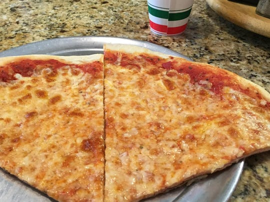 Slices of cheese pizza served at Hickory Tree Pizza in Chatham during the Daily Record Summer Pizza Tour on May 30, 2015.