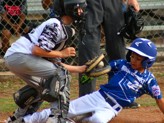Rotary's Brodee Bryars tags a Noon Optimist player