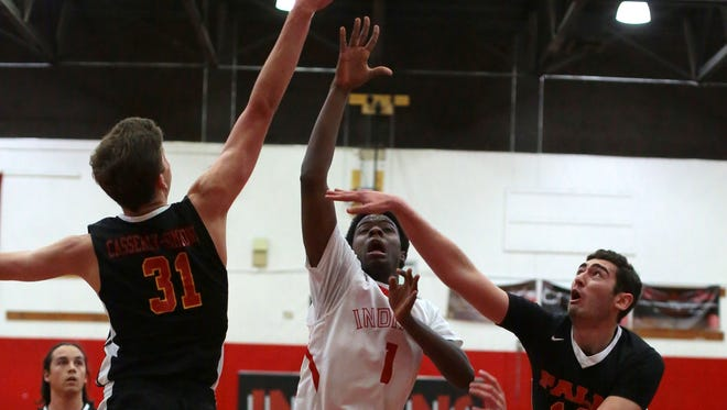 Palm Springs' Deondre Hawkins goes for the basket as Palm Desert's Dalton Casserly-Simmons, left, and Alex McGrath try for a block in the first quarter on Tuesday, January 26, 2016 in Palm Springs.